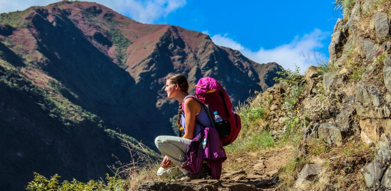 A traveler trekking towards Machu Picchu
